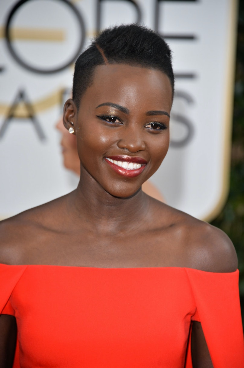 While we're on the fence about her pronounced hair part, __Lupita Nyong'o__'s pale gold eyeshadow and sheer tomato lip gloss were the ideal accompaniment to that Ralph Lauren stunner.