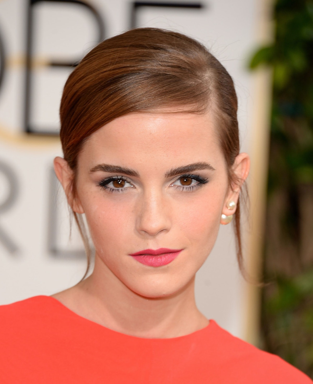From her slightly teased side chignon that channeled Bardot to the matte-pink statement lip, complet...