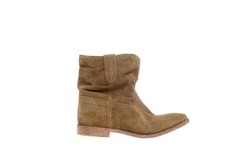 A pair of boots—preferably in a style that I will be able to wear again as spring's Western theme carries into fall. Isabel Marant Crisi suede boots, $790, [matchesfashion.com](http://rstyle.me/n/em86r35fn).