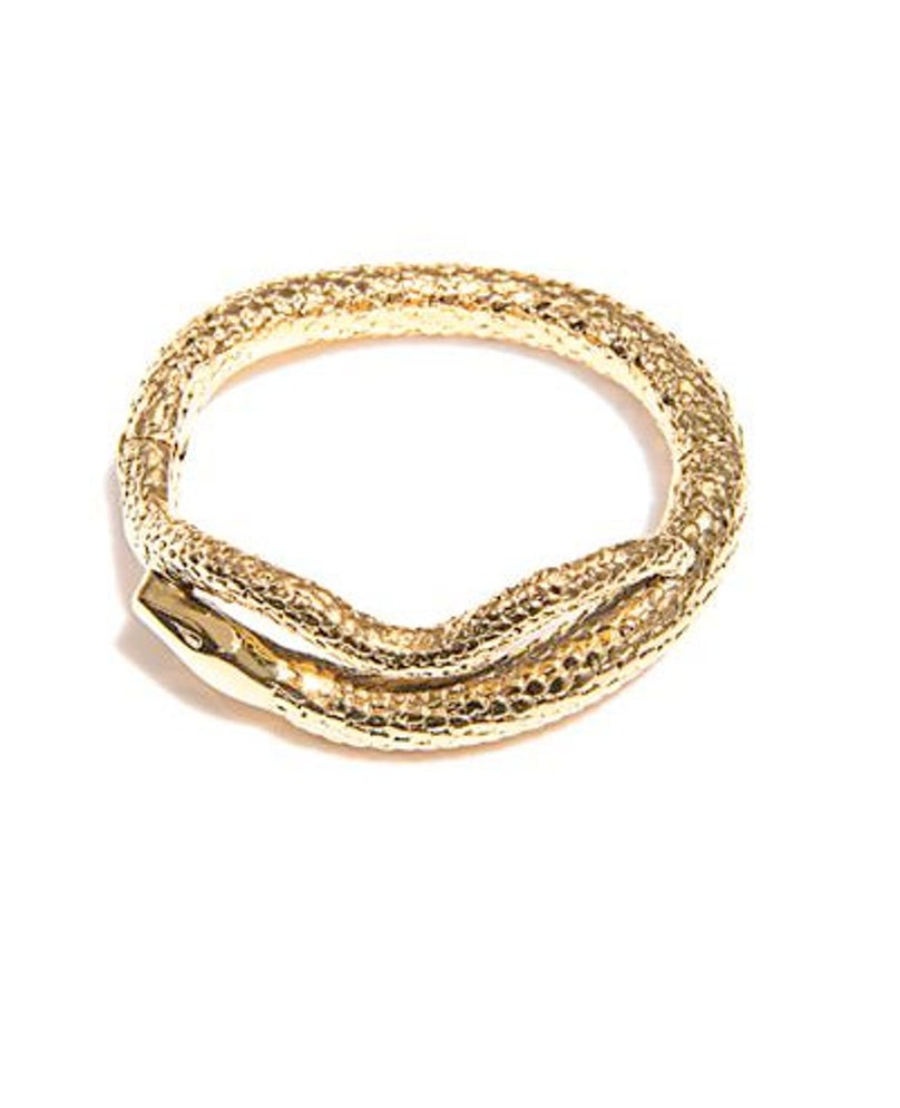 I never travel with a watch, but like to have something to wear on my wrist—like these beautiful Aurelie Bidermann snake cuffs. Aurelie Bidermann Tao gold-plated snake bracelet, $559, [matchesfashion.com](http://www.matchesfashion.com/product/171992).