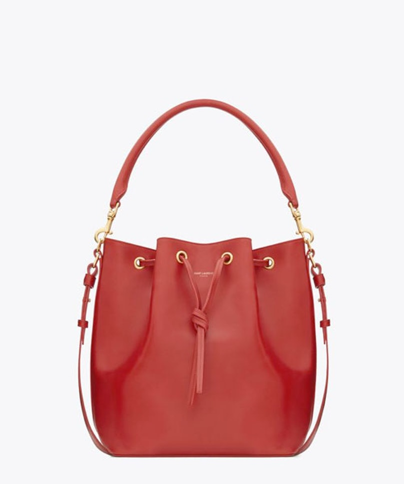 The bucket bag is my new favorite shape— it reminds me of the early '90s and the first bag I ever owned; this warm red is quite pretty. Saint Laurent Paris Seau Saint Laurent medium bucket bag in red leather, $1950, [ysl.com](http://www.ysl.com/us/shop-product/women/handbags-bucket-bag-seau-saint-laurent-medium-bucket-bag-in-red-leather_cod45219621xt.html).