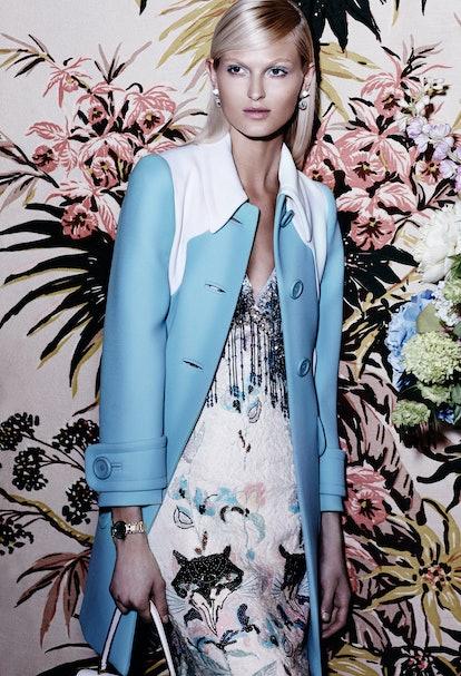 Miu Miu coat, $2,890, dress, $6,845, and bag, $1,850, [miu-miu.com](http://www.miumiu.com/en?cc=US);...