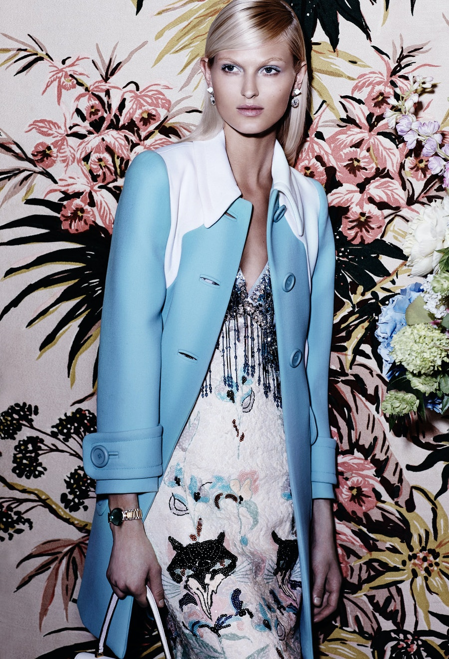 Miu Miu coat, $2,890, dress, $6,845, and bag, $1,850, [miu-miu.com](http://www.miumiu.com/en?cc=US); Givenchy by Riccardo Tisci earrings, $740, [ikram.com](http://ikram.com/). Delfina Delettrez bracelet, $1,560, [openingceremony.us](http://openingceremony.us/).