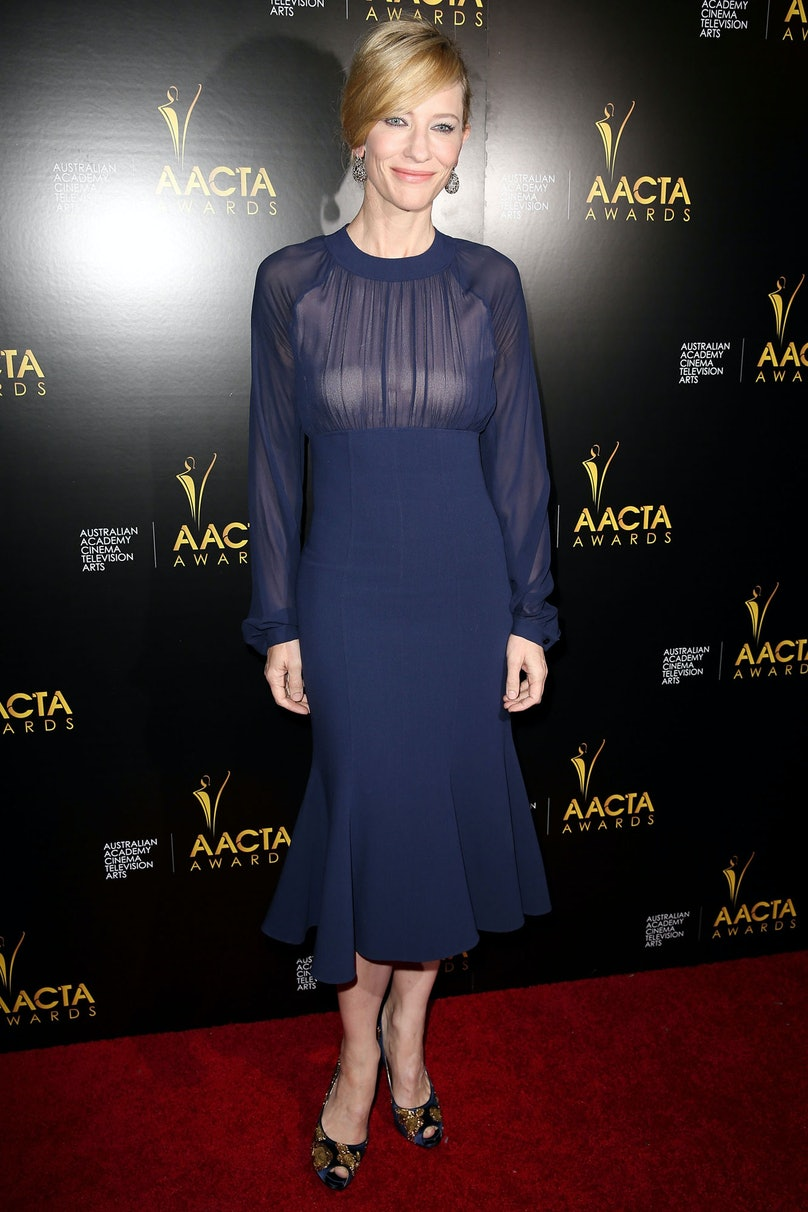 For the AACTA Awards, Blanchett chose a slightly '70s navy flare dress by [Michael Kors](http://www.wmagazine.com/mood-board/filter?q=%5EDesigner%7CMichael%20Kors%7C), [Roger Viver](http://www.wmagazine.com/parties/2013/10/roger-vivier-virgule-heel/photos/) shoes, and Chopard earrings. She accessorized the look post-show with her newly received award for Best Lead Actress.