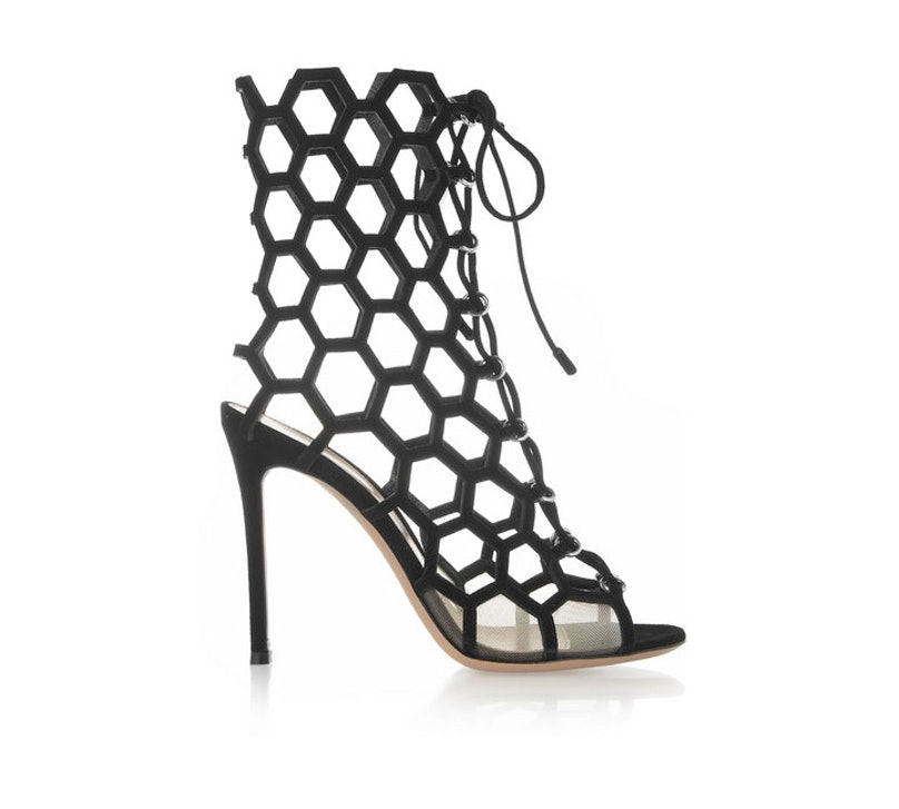 These boots have been on my mind since I first laid eyes on them in June—mainly because I can wear them with tights now during fashion week and then bare legs come spring! *Gianvito Rossi cutout suede sandals, $1450, [net-a-porter.com](http://www.net-a-porter.com/product/406105).*