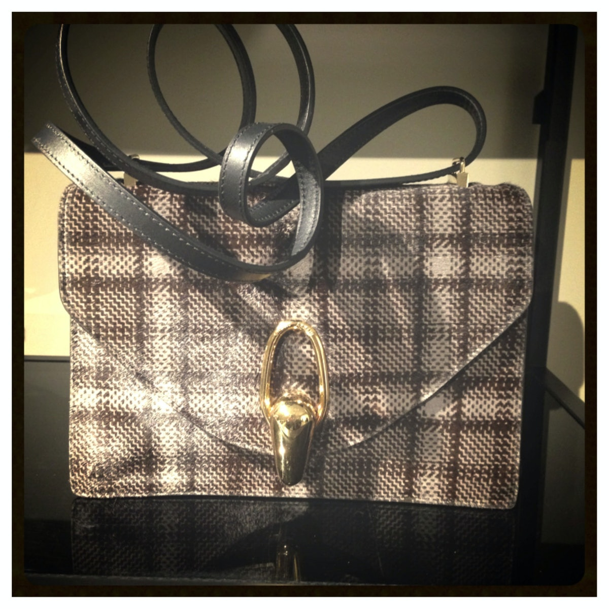 We have our eye on this glen plaid pony hair bag from [Giorgio Armani](http://www.wmagazine.com/mood...
