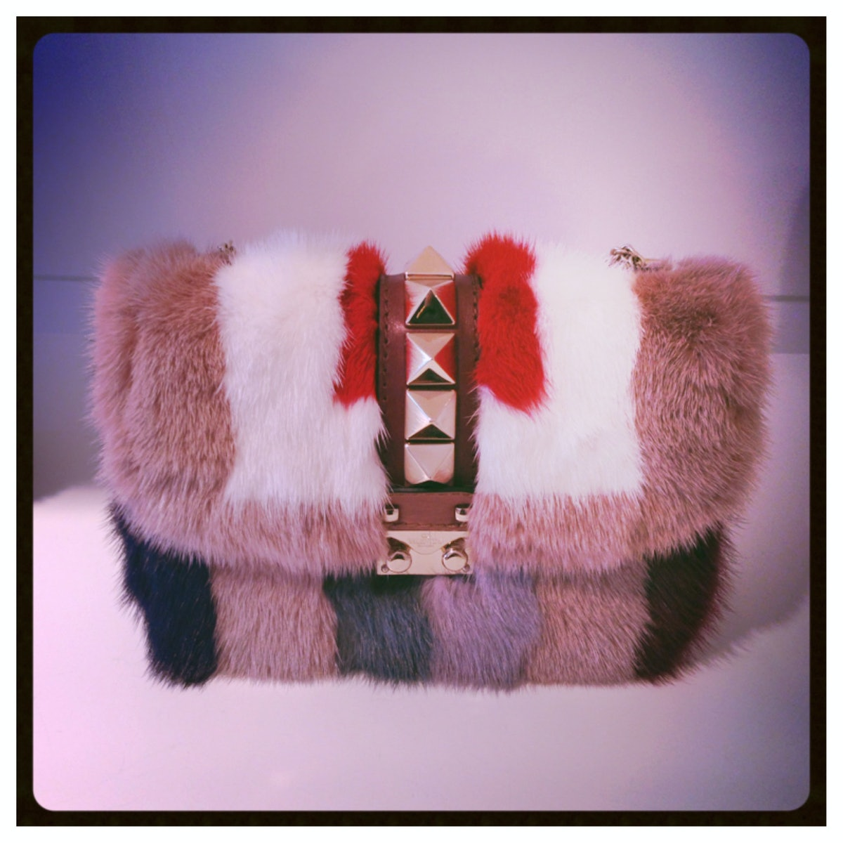 Color blocked fur at [Valentino](http://www.wmagazine.com/mood-board/filter?q=^Designer|Valentino|): What's not to love?