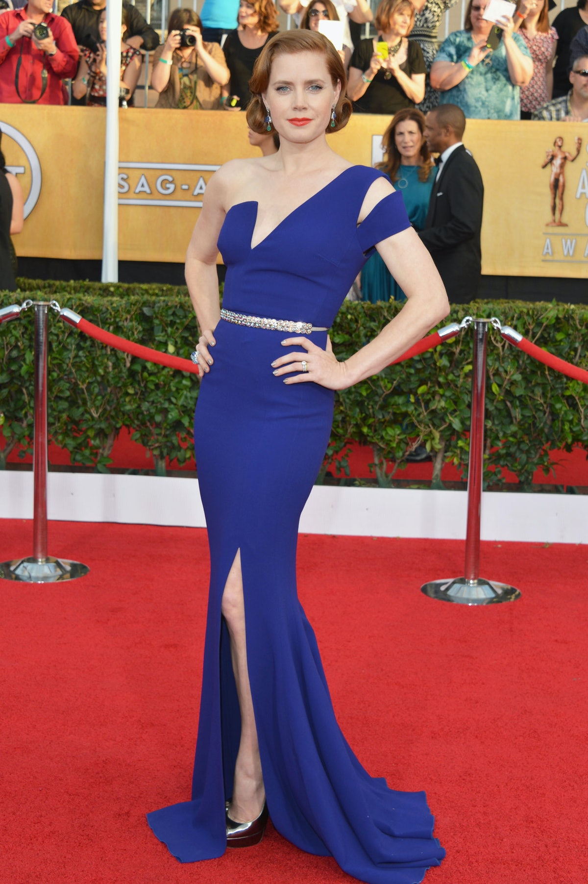 Old Hollywood was the name of the game at the 2014 SAG Awards. With a faux bob, and red lips, [Amy Adams](http://www.wmagazine.com/mood-board/filter?q=%5ECelebrity%7CAmy%20Adams%7C) was the epitome of old-school [glam](http://www.wmagazine.com/mood-board/filter?q=%5ETheme%7CGlam%7C) in royal blue Antonio Berardi, silver [Jimmy Choo](http://www.wmagazine.com/mood-board/filter?q=%5EDesigner%7CJimmy%20Choo%7C) platforms (with matching nail polish), and classic Cartier jewels. Photo by Getty Images.