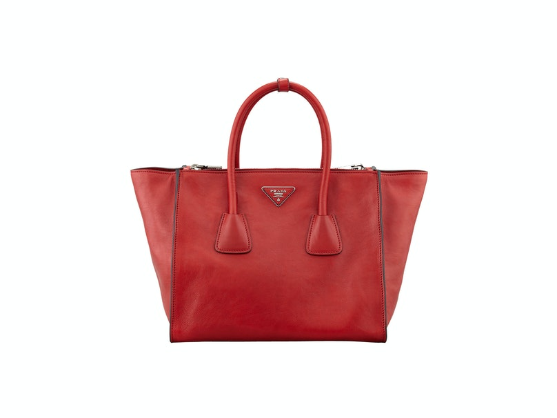 Prada tote bag, $2400, [neimanmarcus.com](http://www.neimanmarcus.com/Prada-Glace-Calf-Twin-Pocket-Tote-Bag-Red-Glace-Calf-Twin-Pocket-Tote-Bag/prod159410145___/p.prod?icid=&searchType=MAIN&rte=%252Fsearch.jsp%253FN%253D0%2526Ntt%253DGlace%252BCalf%252BTwin%252BPocket%252BTote%252BBag%2526_requestid%253D64784&eItemId=prod159410145&cmCat=search).