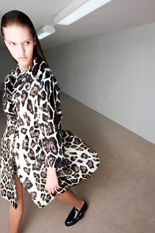 __Giambattista Valli__: A leopard-print coat in a timeless silhouette.