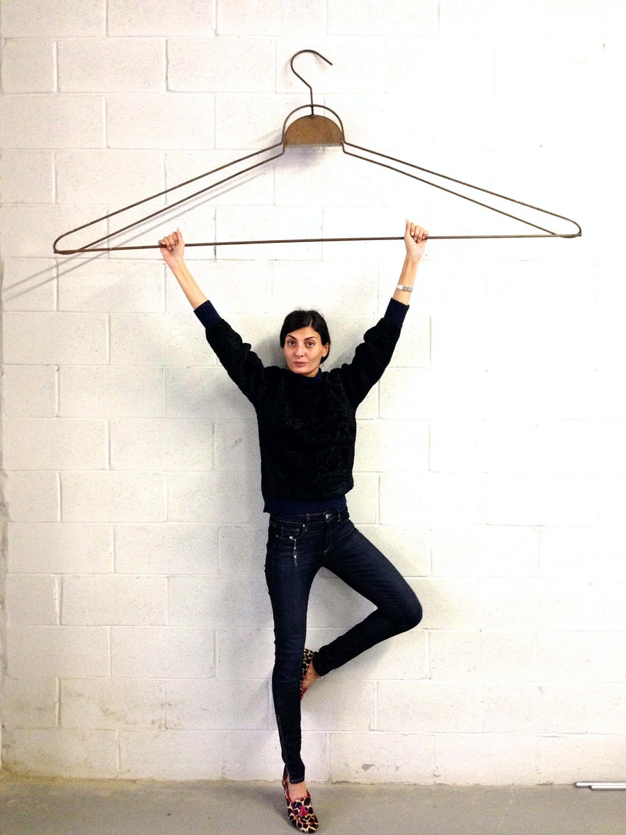 """""""While working in Brooklyn with the photographer Paola Kudacki, I kept noticing this gigantic hanger on a wall of the studio. When we were done, I did a mini gymnastics performance, and Paola took a photo. It was like fashion trapeze— and I was the ultimate clothes hanger!"""""""