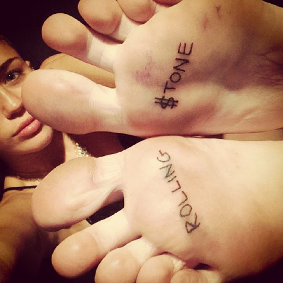 __#Inked:__ Cyrus has only to flash her feet—and her latest tattoo—to get people's attention.