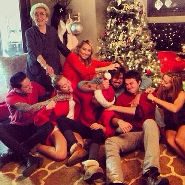 __#TBT:__ The day after Christmas, Cyrus shared this festive family snap—tongue included of course.