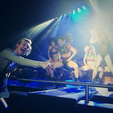 __#SuperFan:__ Cyrus couldn't control her excitement to be front row center at kick off of Britney S...