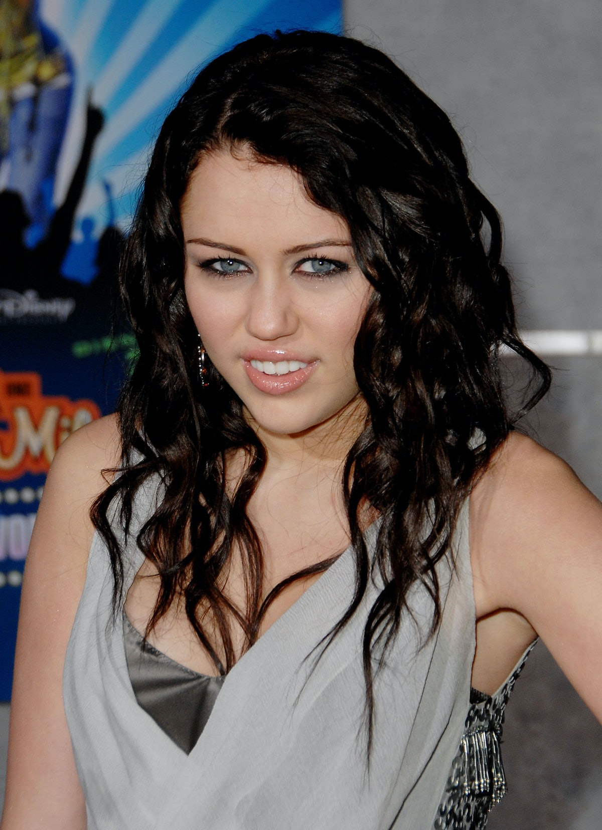 """Cyrus stole Christina Aguilera's """"DIRRTY"""" look at the January 2008 premiere of the Best of Both Worl..."""