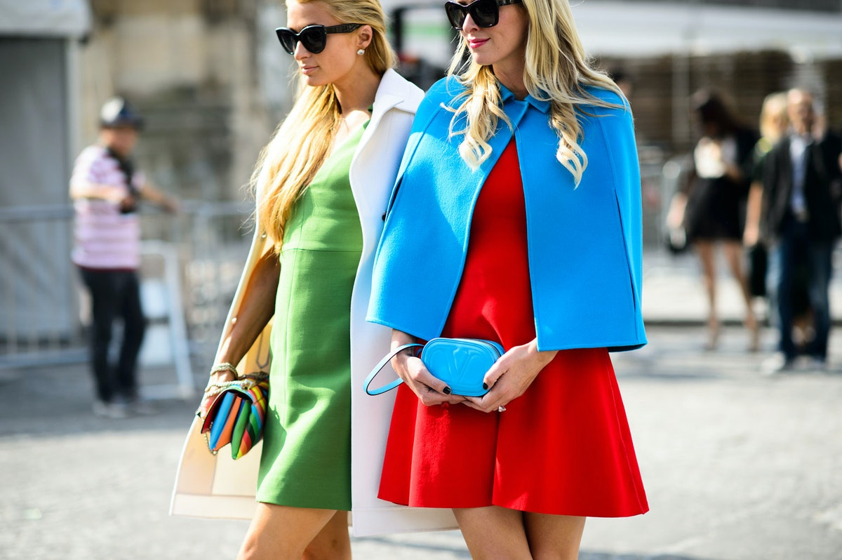 Nicky and Paris Hilton attend Paris Fashion Week Spring 2015 Day 8