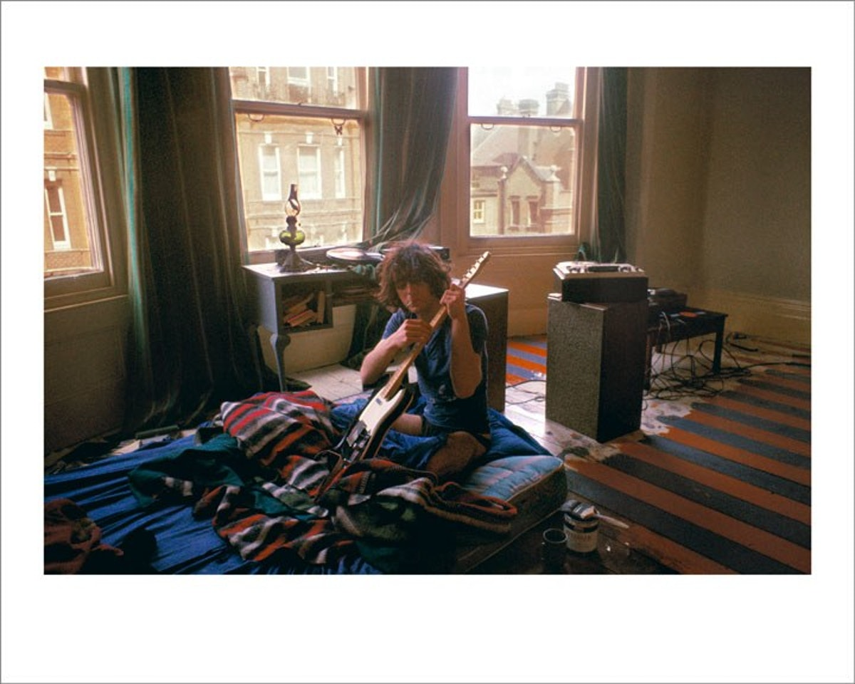 Syd Barrett tuning his guitar in London, 1969 by Mick Rock