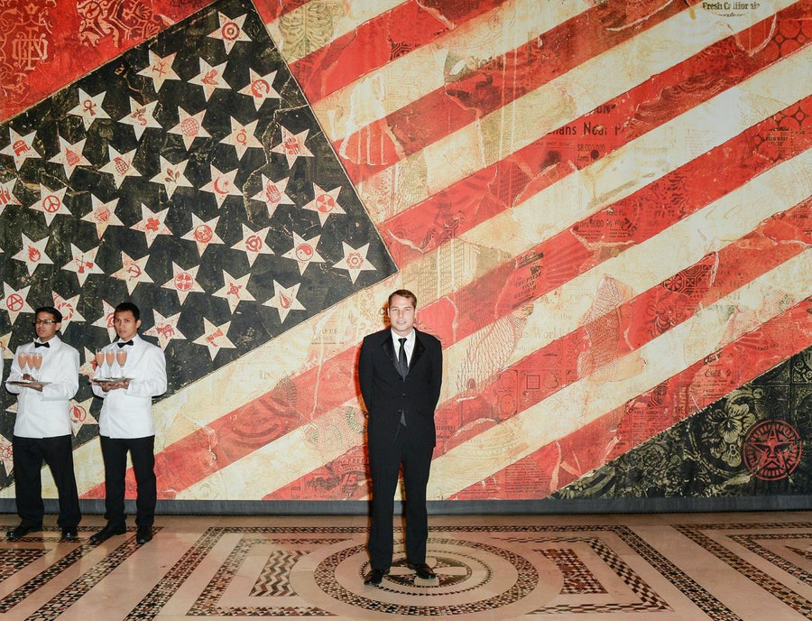 Shepard Fairey in front of his print