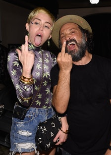 Miley Cyrus and Mr. Brainwash attend the Haute Living Hublot party at the estate of JR and Loren Rid...