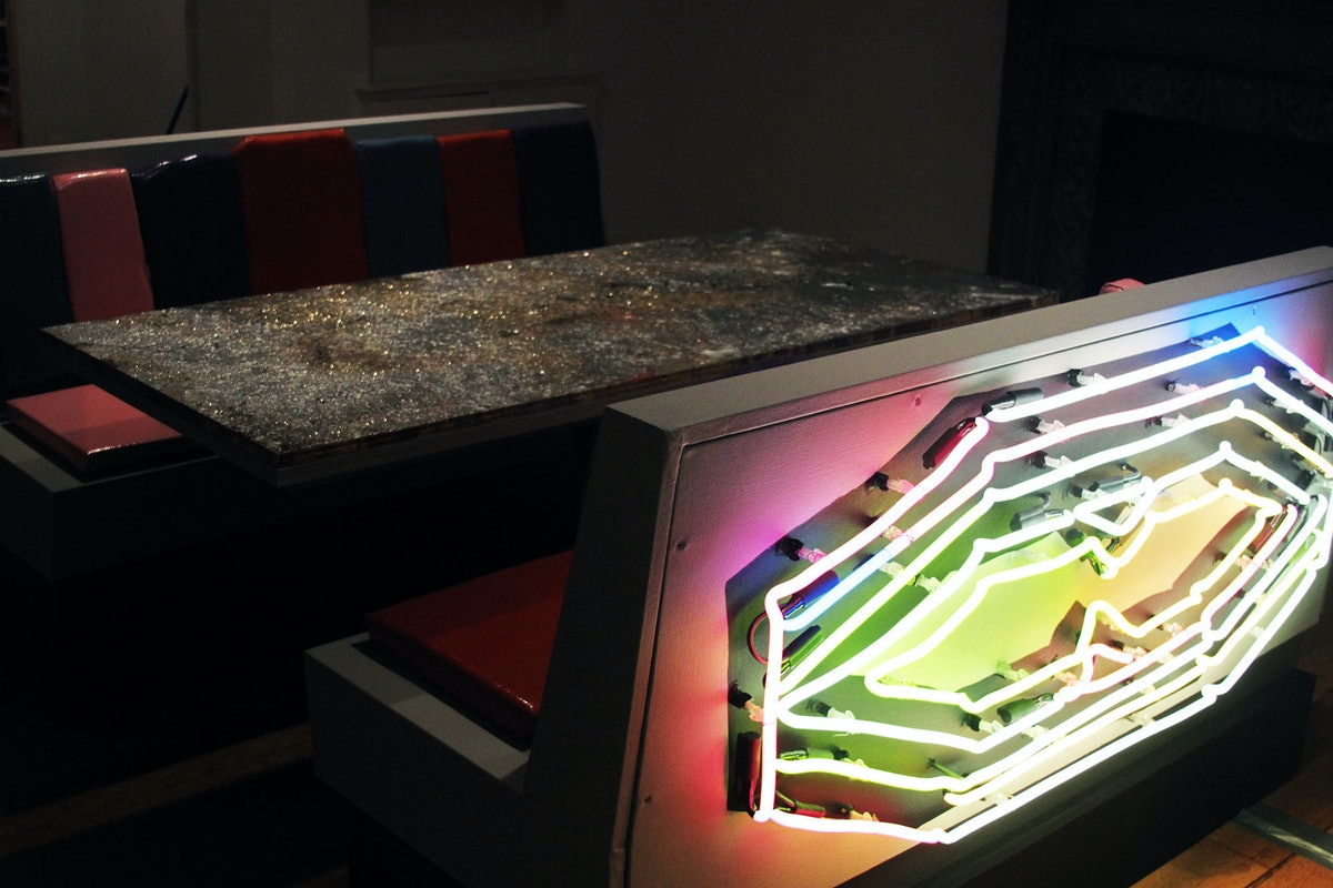 Blair Thurmana's neon light piece on the back of one seat