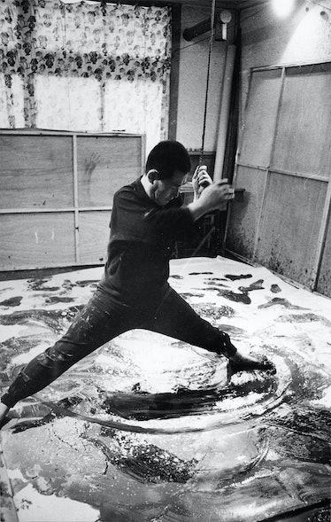 Kazuo Shiraga in his studio