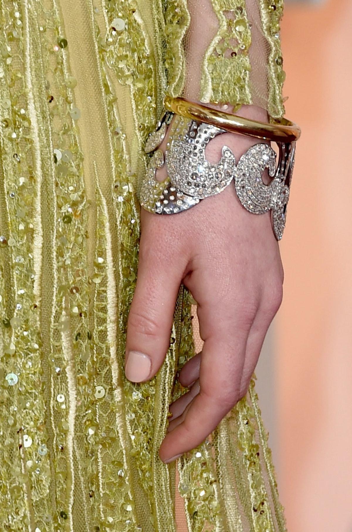 Emma Stone in Tiffany & Co. cuffs