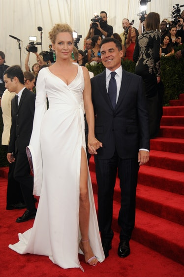 Uma Thurman in an Atelier Versace dress and Alexandre Birman shoes with Andre Balasz