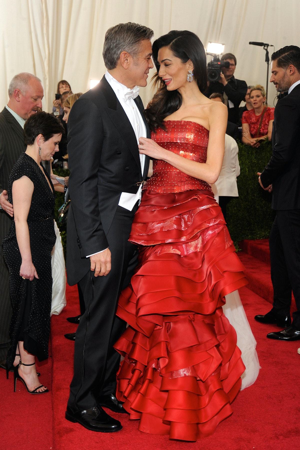 George Clooney in Georgio Armani and Amal Clooney in Margiela
