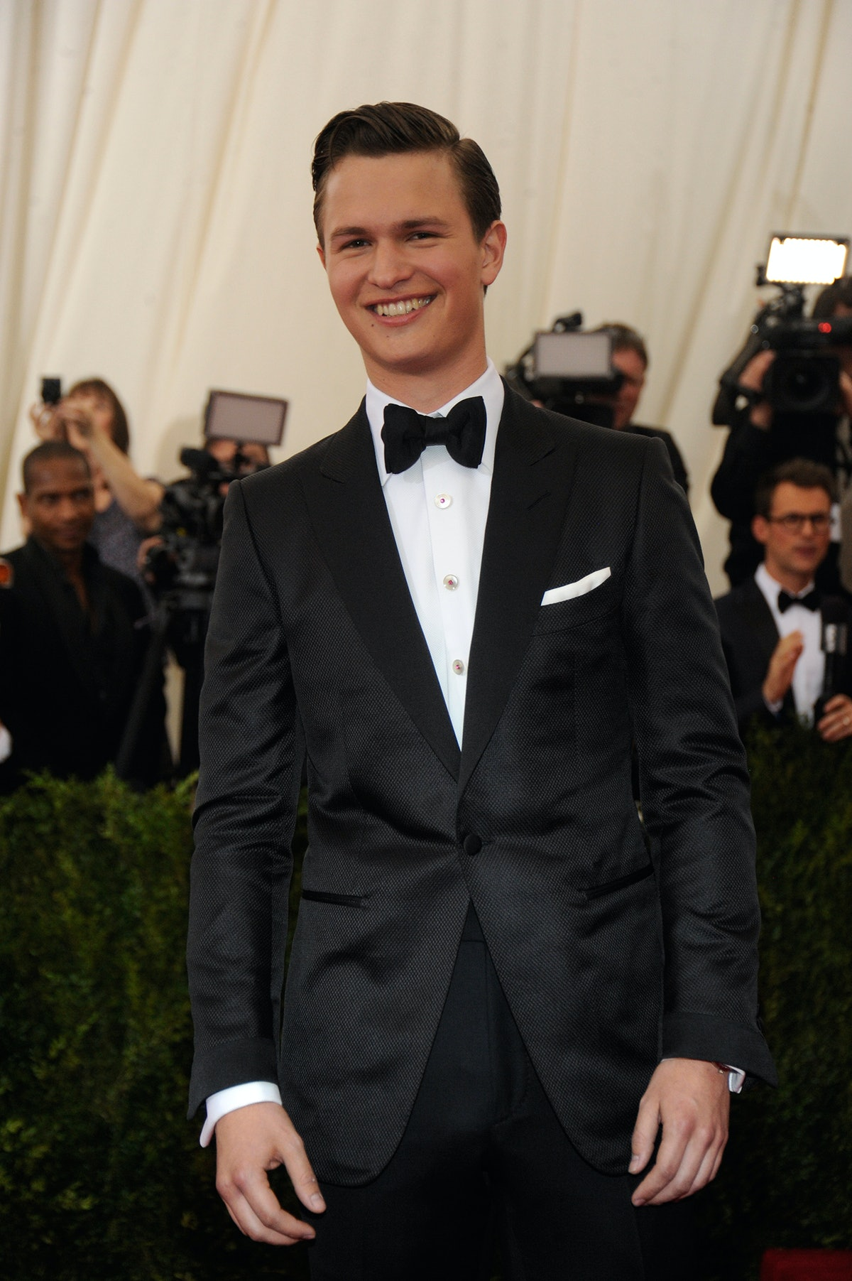 Ansel Elgort in a Tom Ford suit and Beladora studs