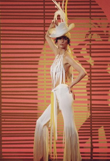 Cher posing in white