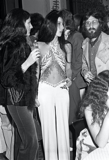 Cher wearing a halter top