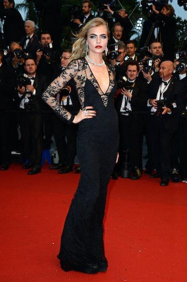 Cara Delevingne on a red carpet.