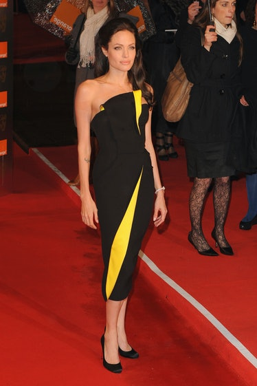 Angelina Jolie in a black and yellow dress