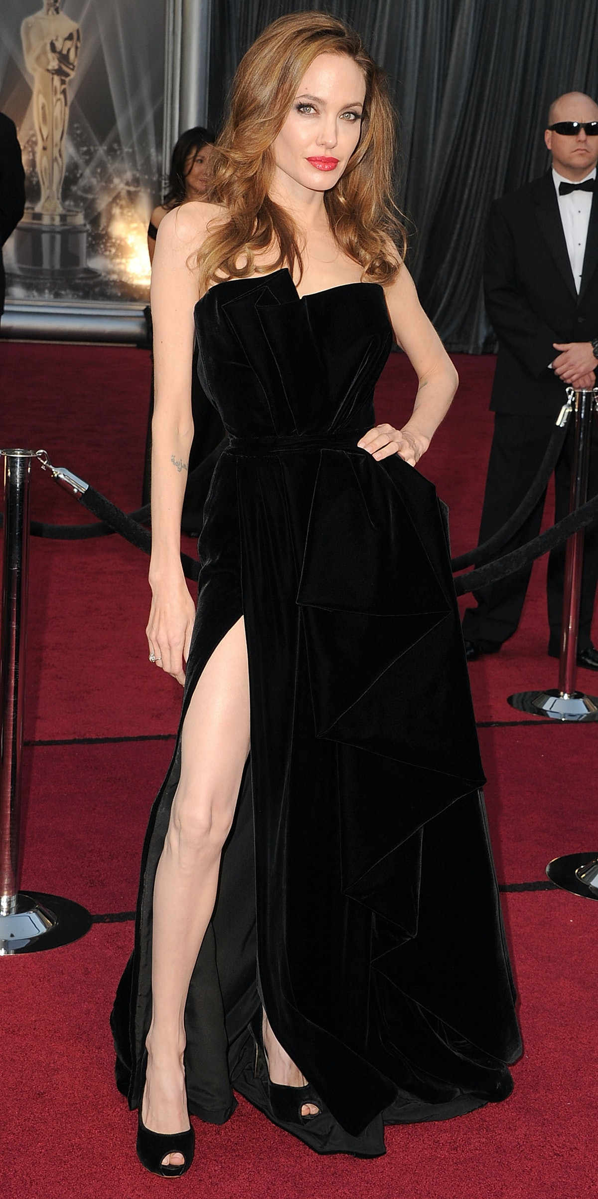 Angelina Jolie posing in a black dress