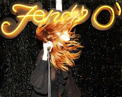 blog-Lykke-Li-%28wearing-FENDI%29-performance-with-neon-sign.jpg