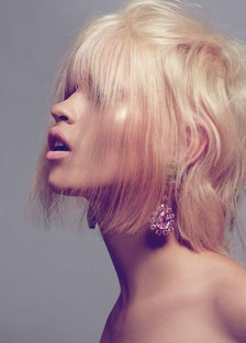 Prada earrings. __Beauty note:__ Hair gets hit with surprising pops of the extraordinary with Kevin ...