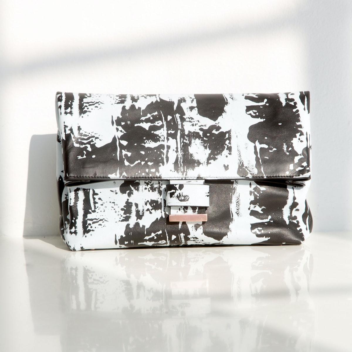 Cédric Charlier multicolored clutch, $595, [shopbop.com](http://www.shopbop.com/multi-colored-clutch-cedric-charlier/vp/v=1/1516857067.htm?folderID=25901&fm=other-shopbysize-viewall&colorId=10917)