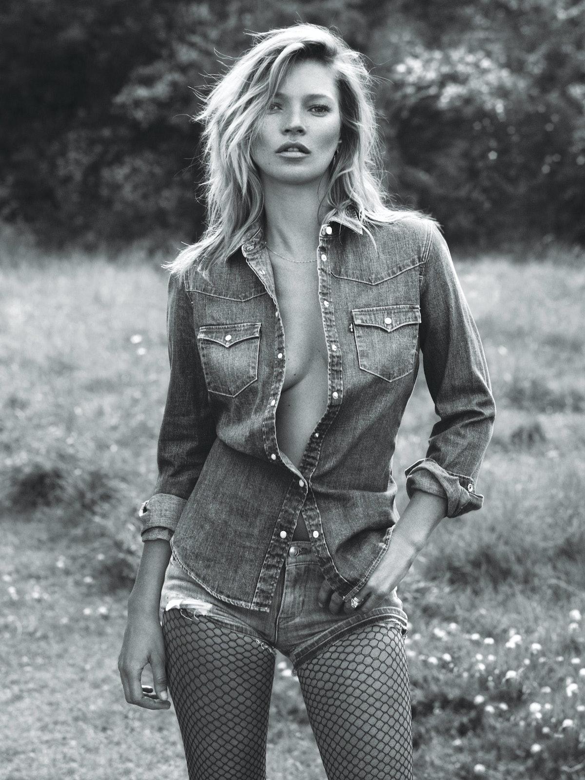 Kate Moss wearing an open denim shirt