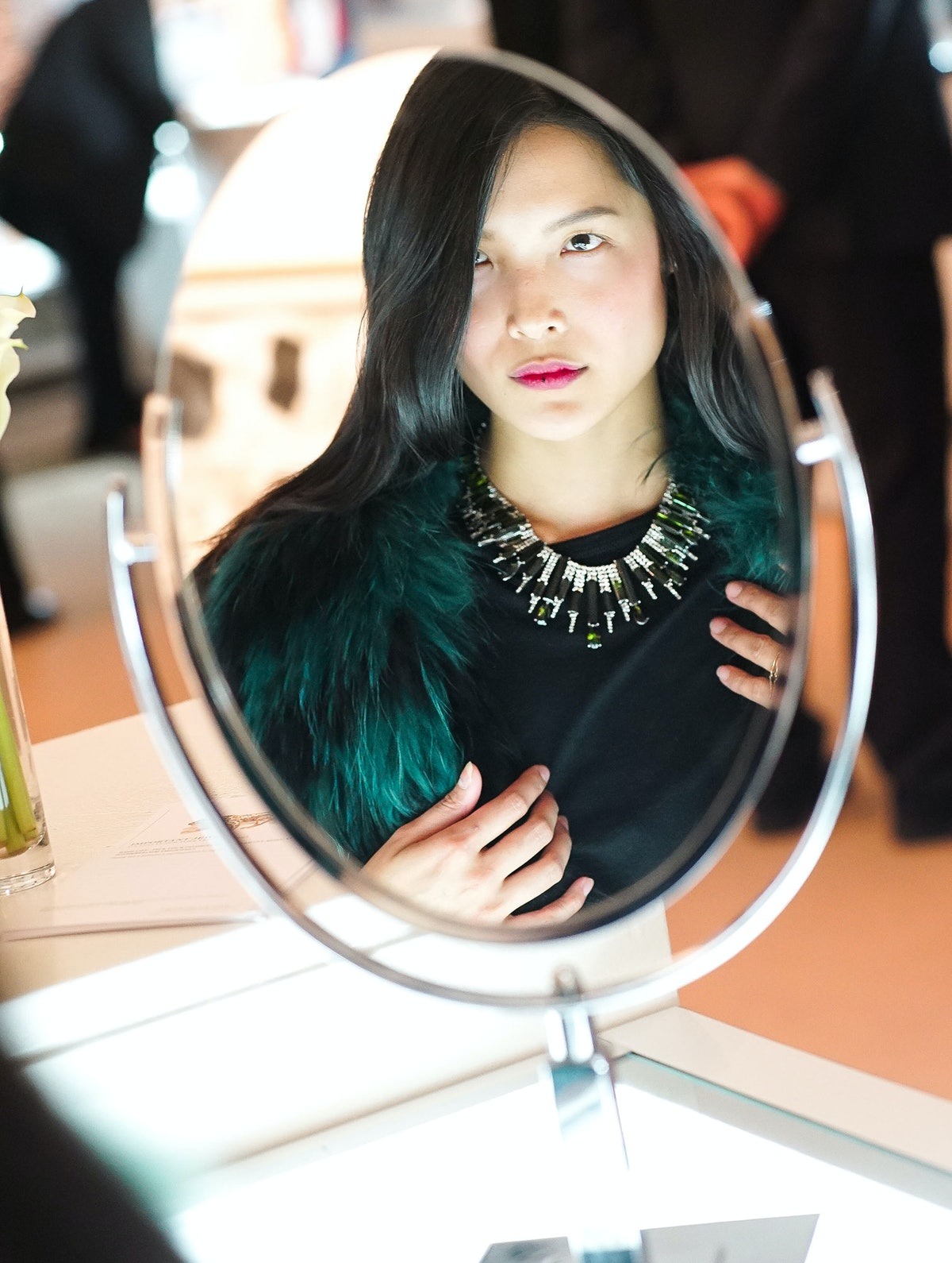 Dalad K tries on a necklace at Sotheby's preview of Important Jewels