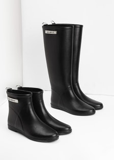 Alice + Whittles black rubber ankle boot