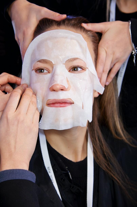 A model wears an SK-II mask backstage
