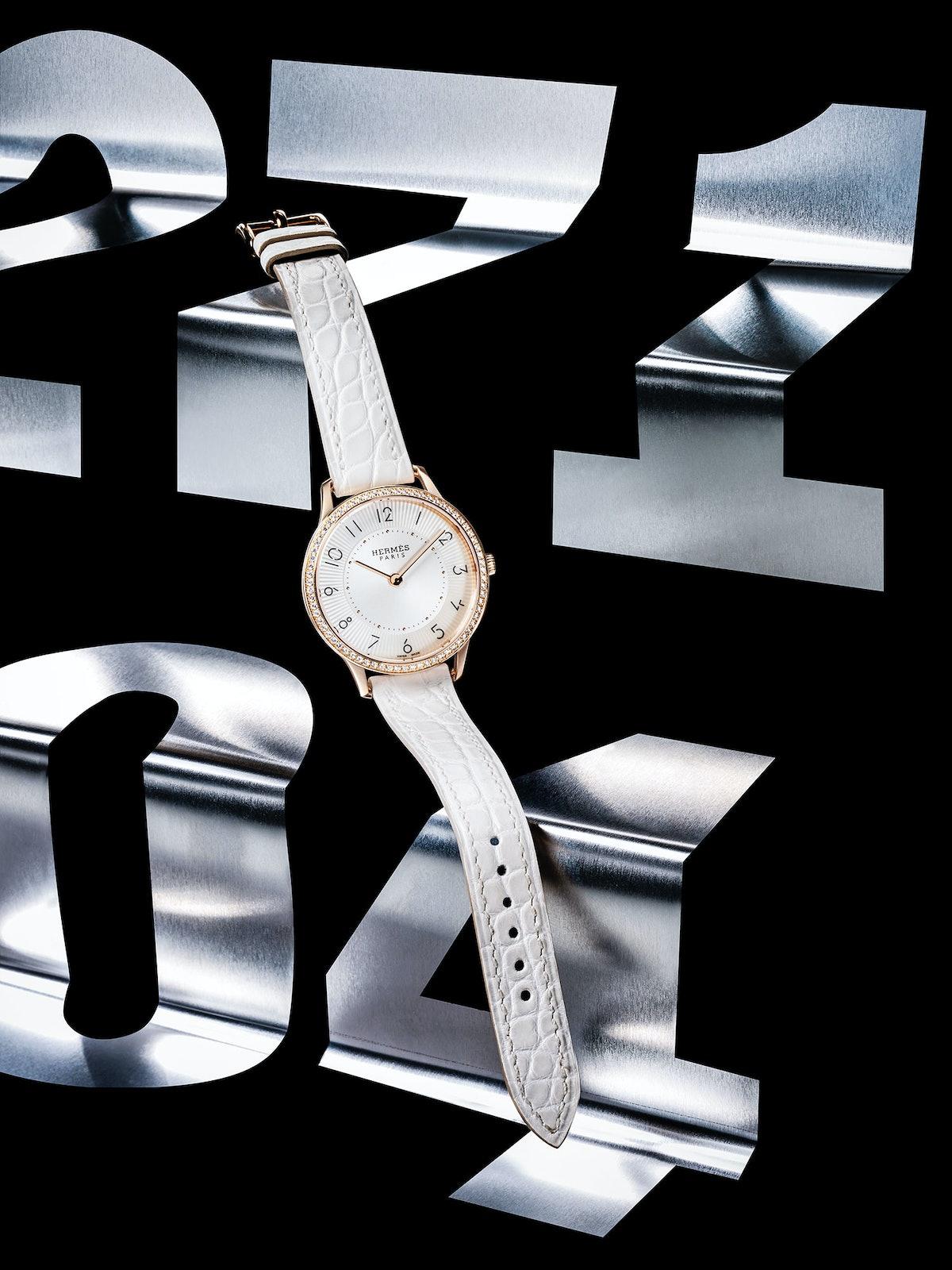 Hermès gold and diamond watch