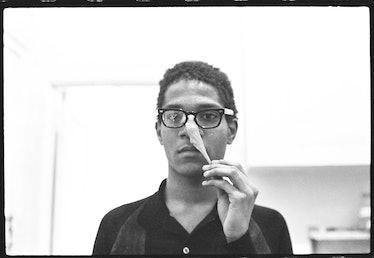Basquiat performing in the apartment, c. 1980.jpg