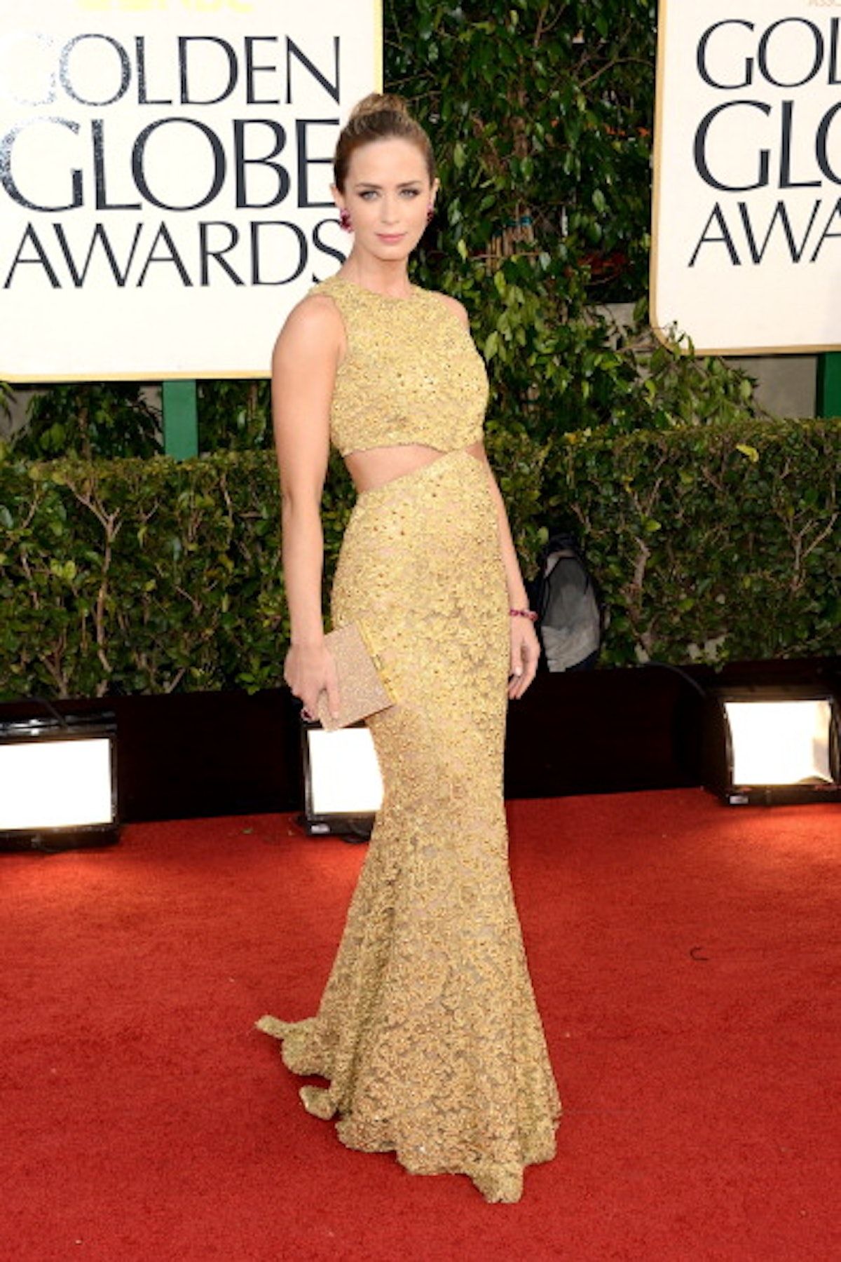 Emily Blunt in a gold dress.