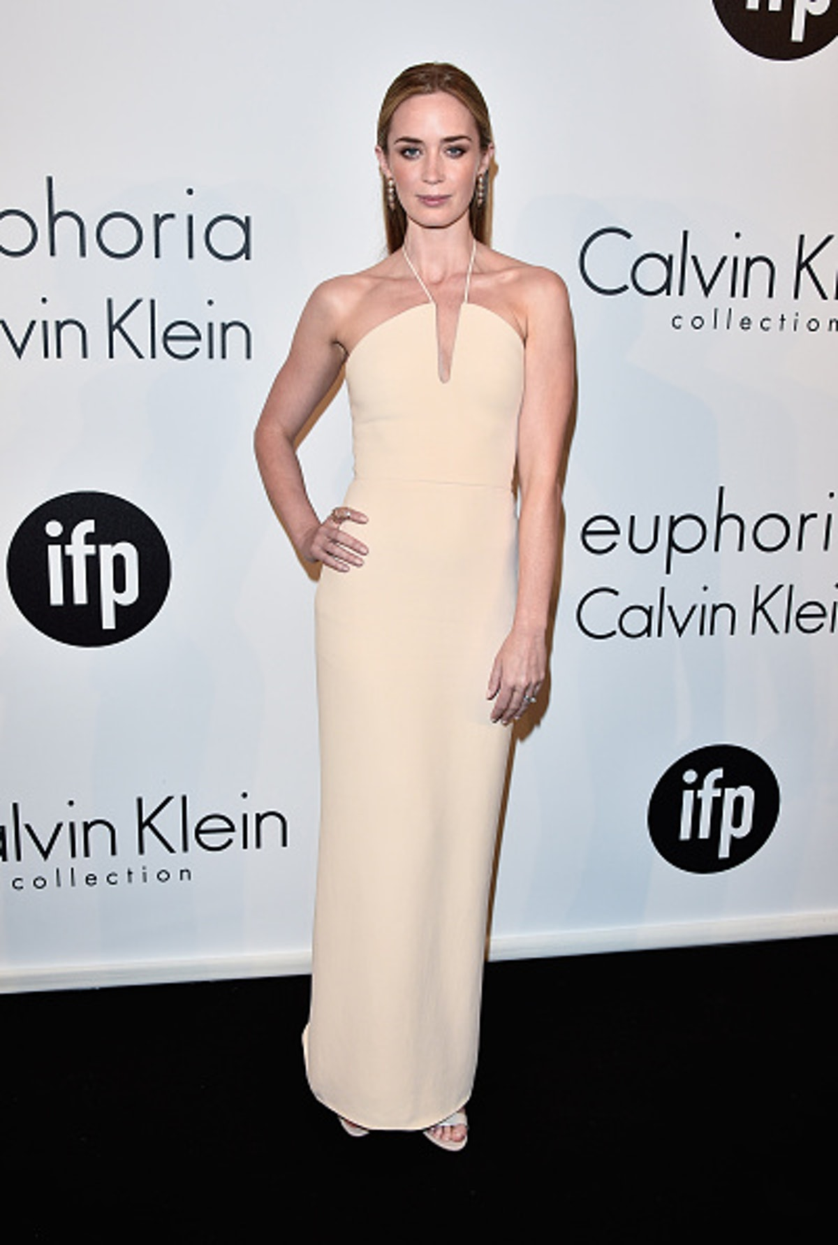 Emily Blunt in beige gown.