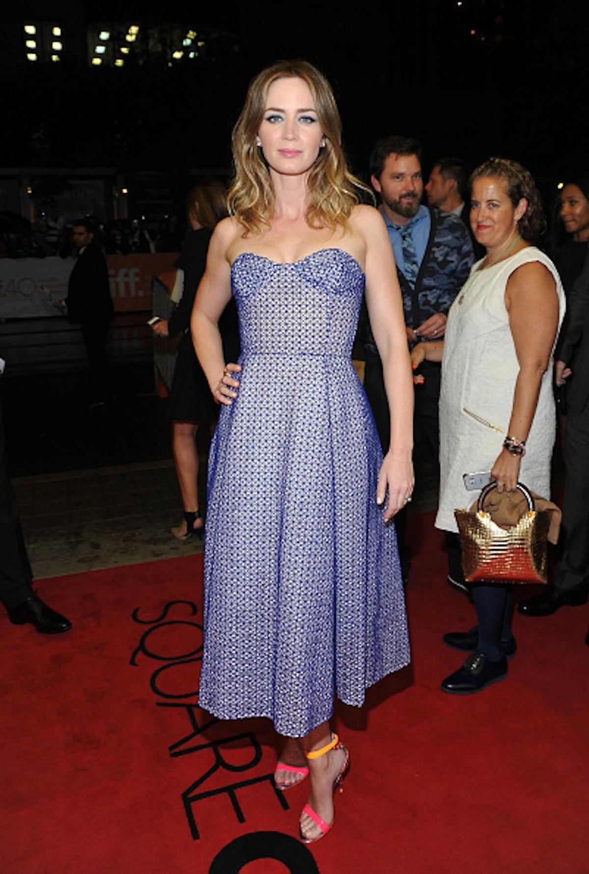 Emily Blunt in a blue little dress.