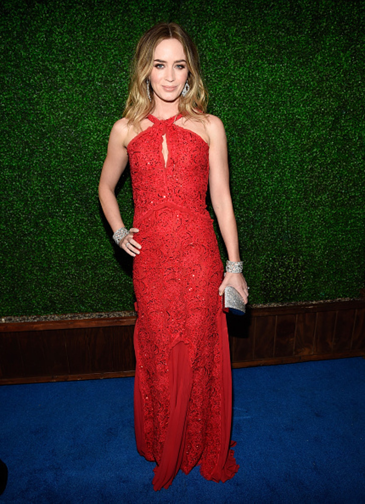 Emily Blunt in a sophisticated red gown.