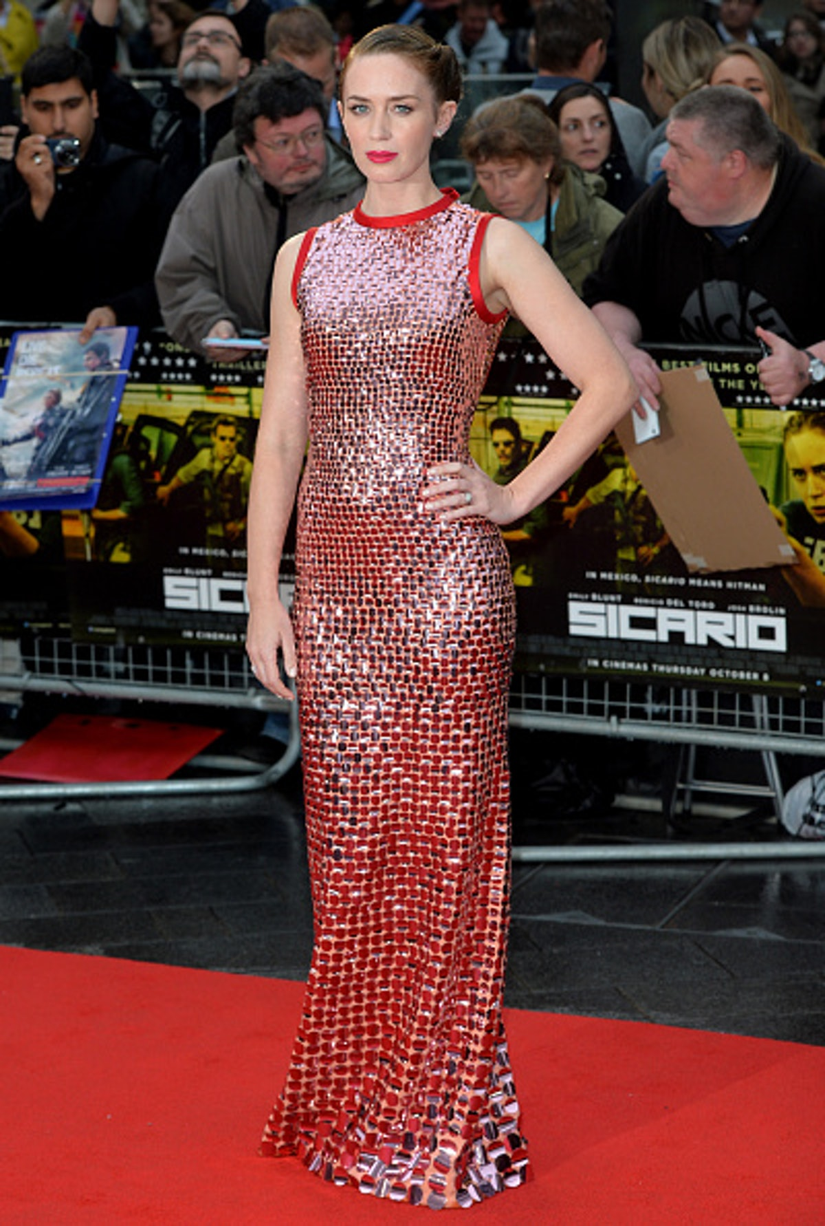 Emily Blunt in a shiny disco ball material.