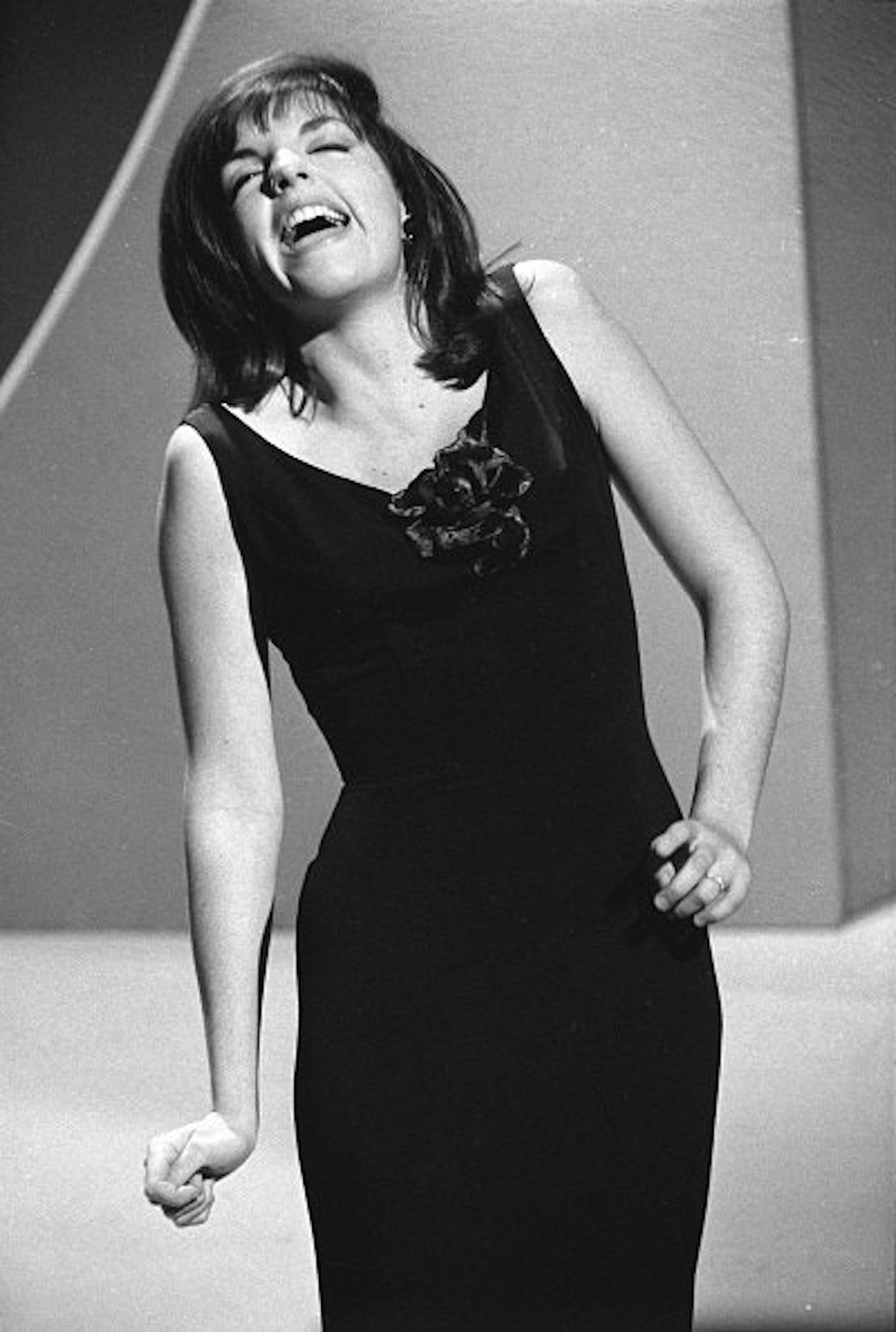 Liza wearing a classic black dress