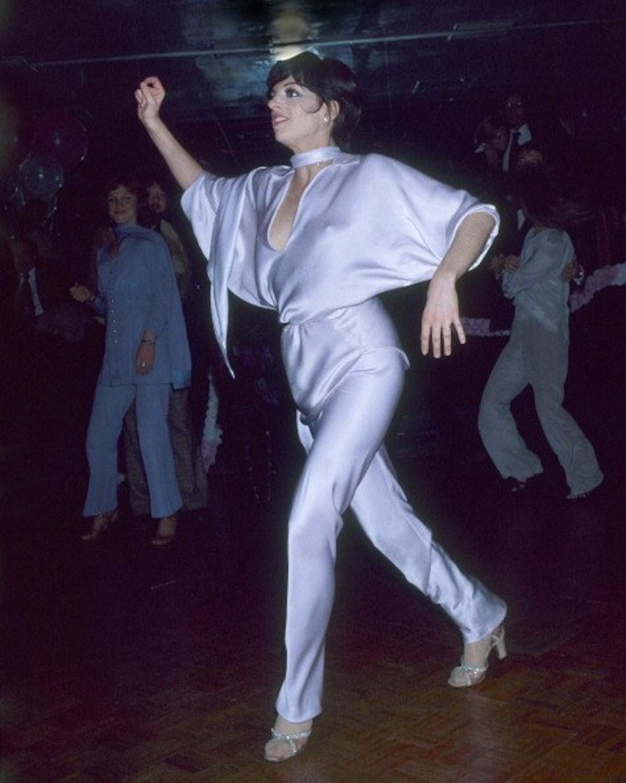 Liza dances in purple silk jumpsuit